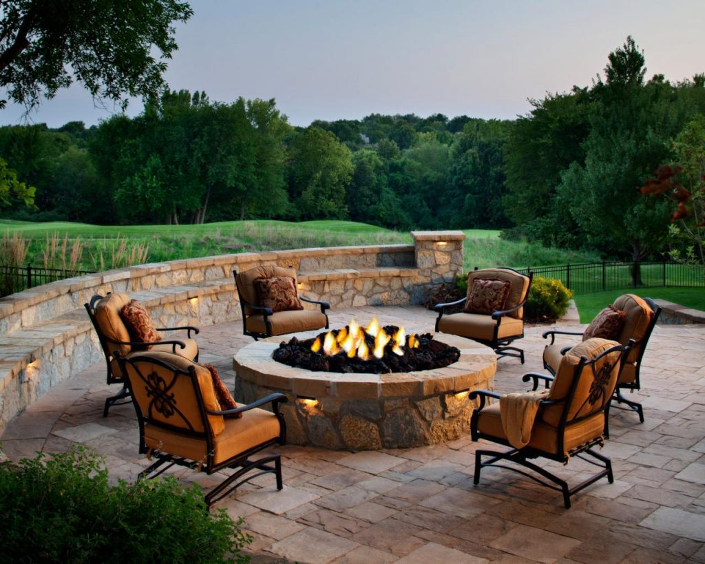 Adding a fire pit is the quintessential outdoor living amenity that adds value and comfort to your home